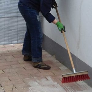Cleaning concrete pavers